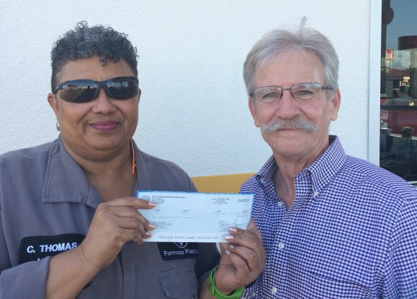 Red Dot Grocery owner Colleen Thomas (left) receives $10,000 check from CDC's Patrick J. Kennedy (right)