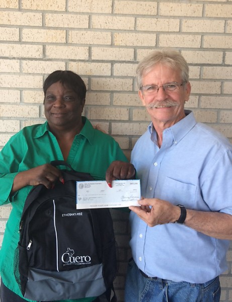 Tri-City Empowerment Council CEO-Founder Viola M. Holman (left) receives $10,000 check from CDC's Patrick J. Kennedy (right)