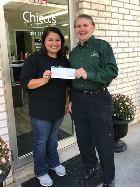Chica's Beauty Salon owner MaryJane Henson (left) receives $4,740 check from the CDC's Randy Jochim (right)