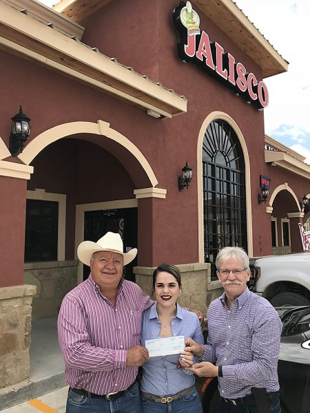 Lupe Leon (left) and Aideth Leon (center) of the G. Leon Family Partnership (Taqueria Jalisco) receive $10,000 check from CDC's Patrick J. Kennedy (right)