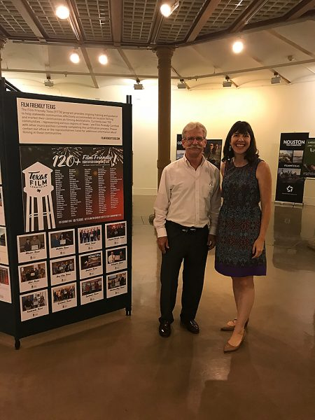 CDC's Patrick J. Kennedy (left) and Texas Film Commission's Kim LeBlanc (right) visit the Film Friendly Texas Exhibit at Texas State Capital