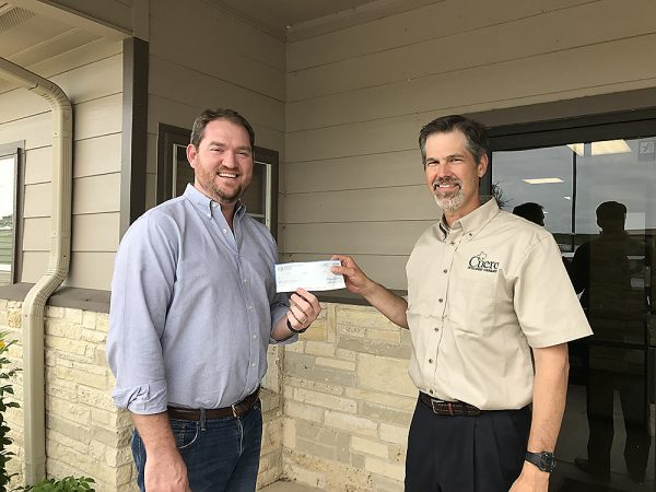 Encompass Technologies, LLC co-founder Fielding Hickey (left) receives $10,000 check from Cuero Development Corporation board member Chris Crain (right)