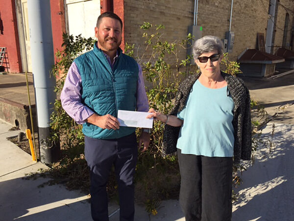Ann Parks Hedrick (right) receives $10,000 grant check from CDC's Greg Freeman (left)