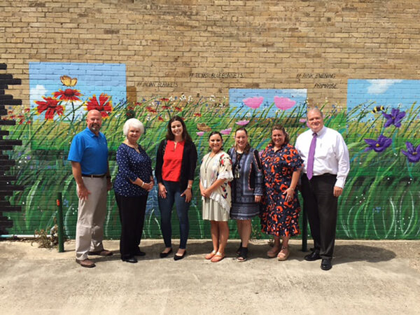 Group photo of Cuero community leaders with Kate Stanford from Texas Economic Development