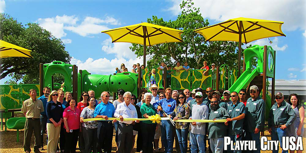 Photo of ribbon-cutting ceremony at new playground equipment in Cuero Municipal Park